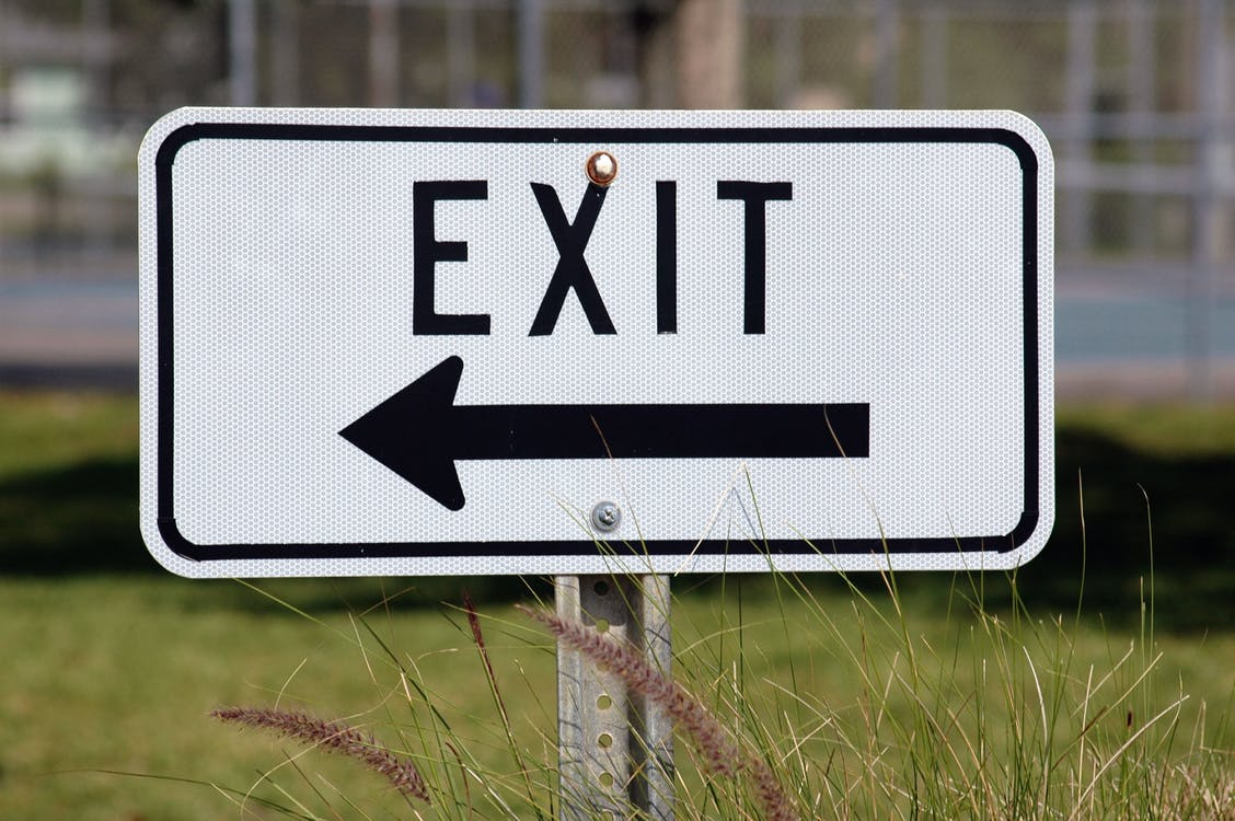 Exit Signage Pointing at Right Side