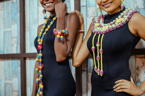 Women Wearing Beaded Necklace