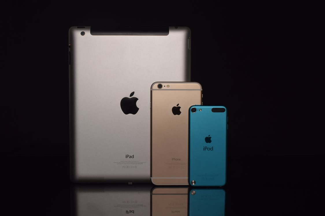 Space Gray Ipad, Gold Iphone 6, and Blue Ipod Touch