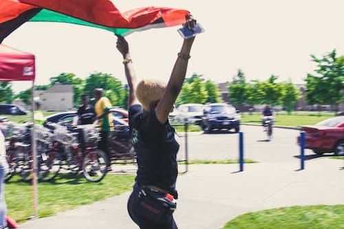 Foto d'estoc gratuïta de Àfrica, bandera verda negra vermella, bici