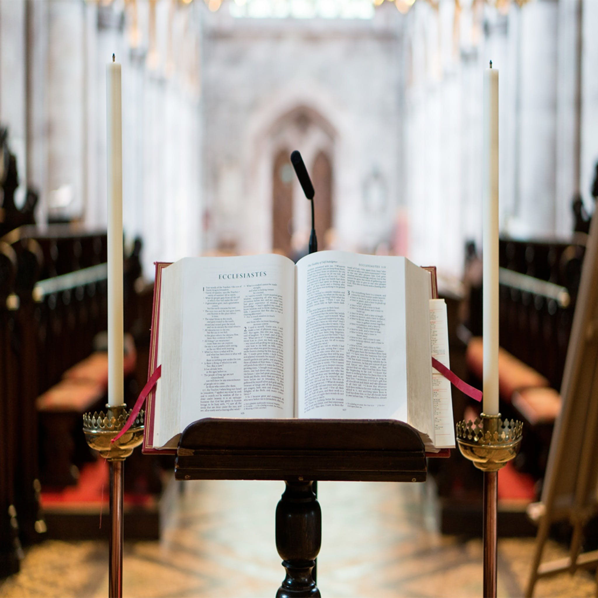 Bible on Stand Between Candles Inside Hall