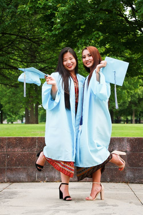 Two Women in Blue Academic Regalia