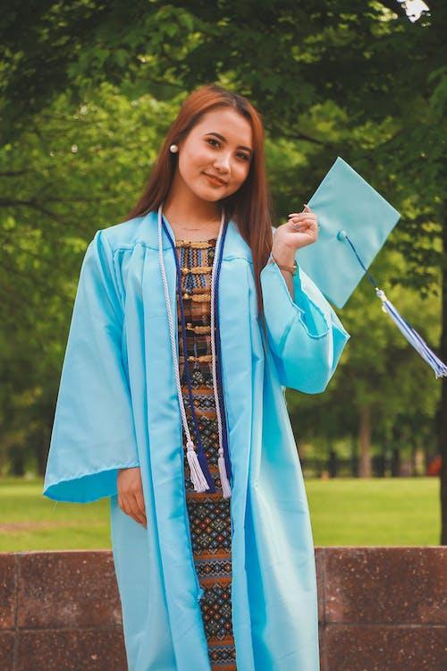 Woman Wearing Blue Academic Dress
