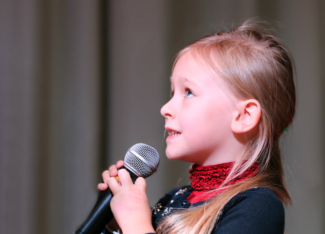 Girl Holding Black Dynamic Microphone While Looking Above