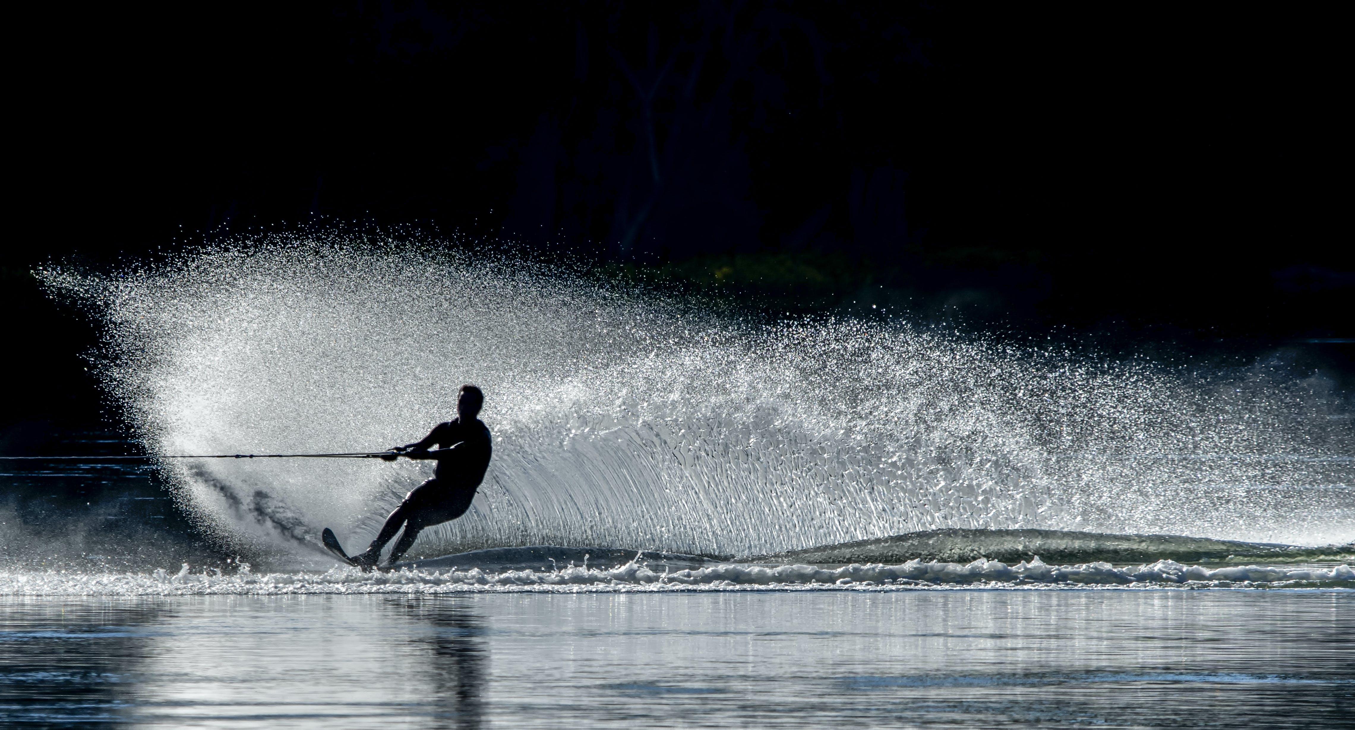 Person Water Skiing at Night