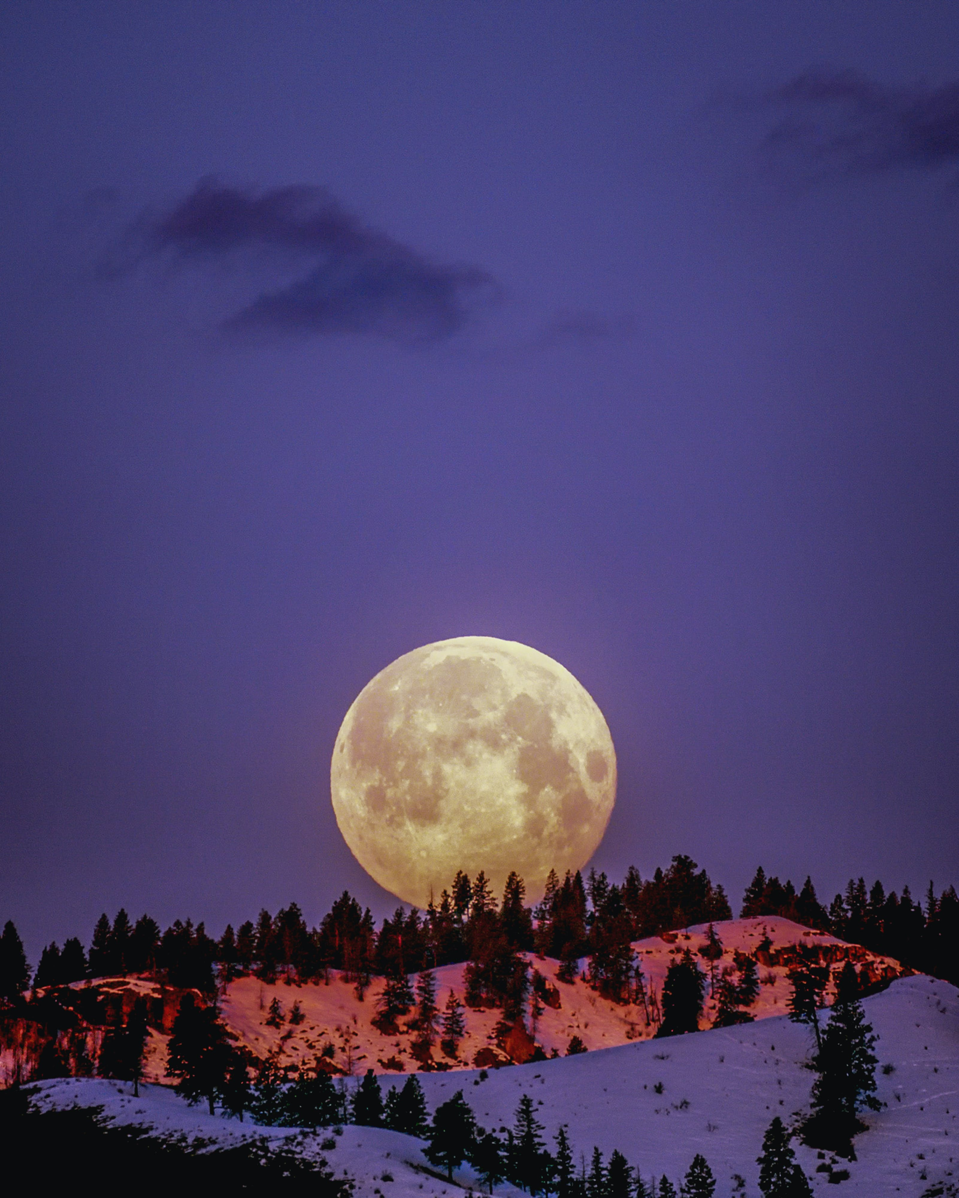 Moon Over Snowcapped Mountain