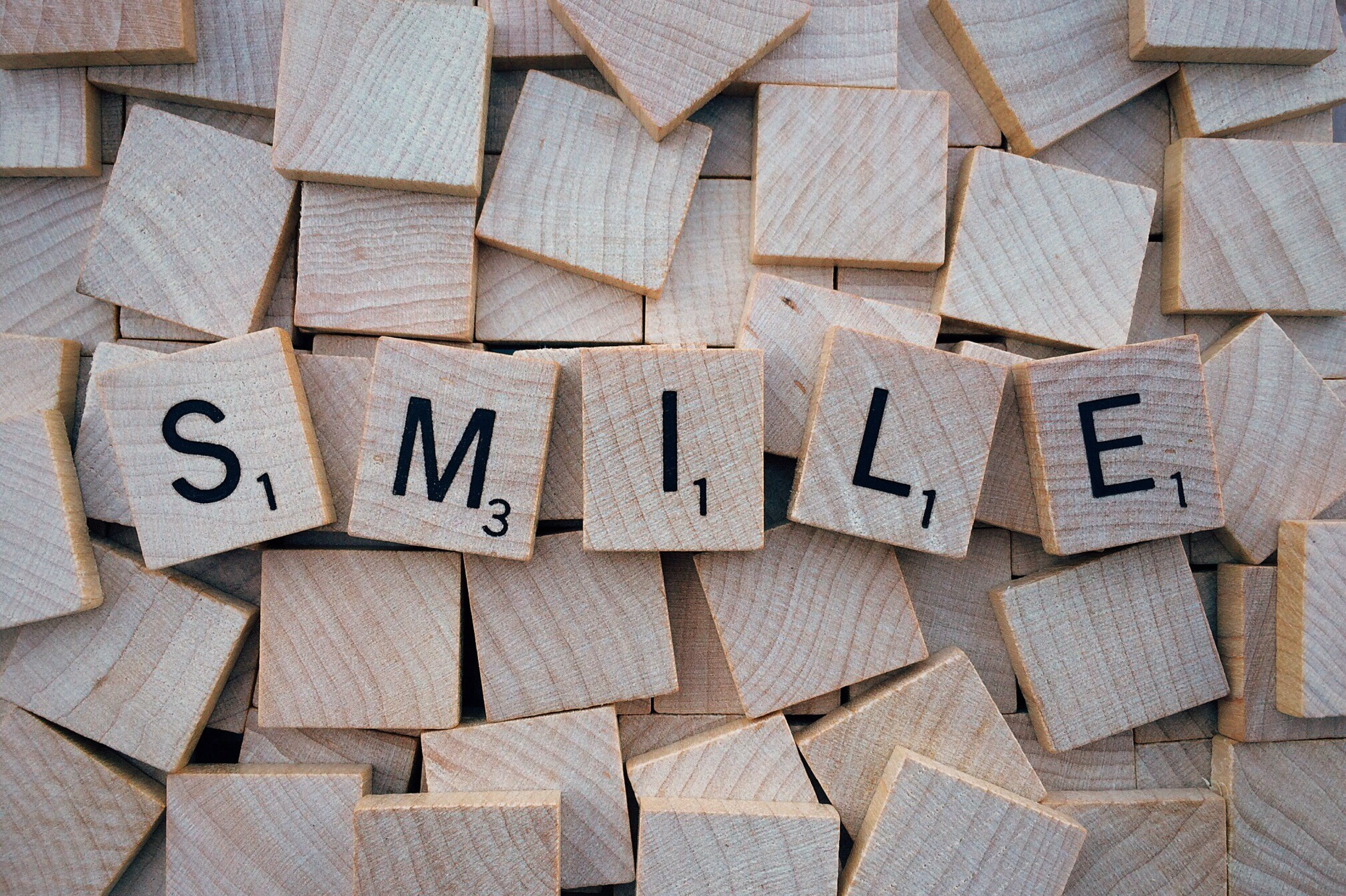 Brown Wooden Smile Scrabble Tiles