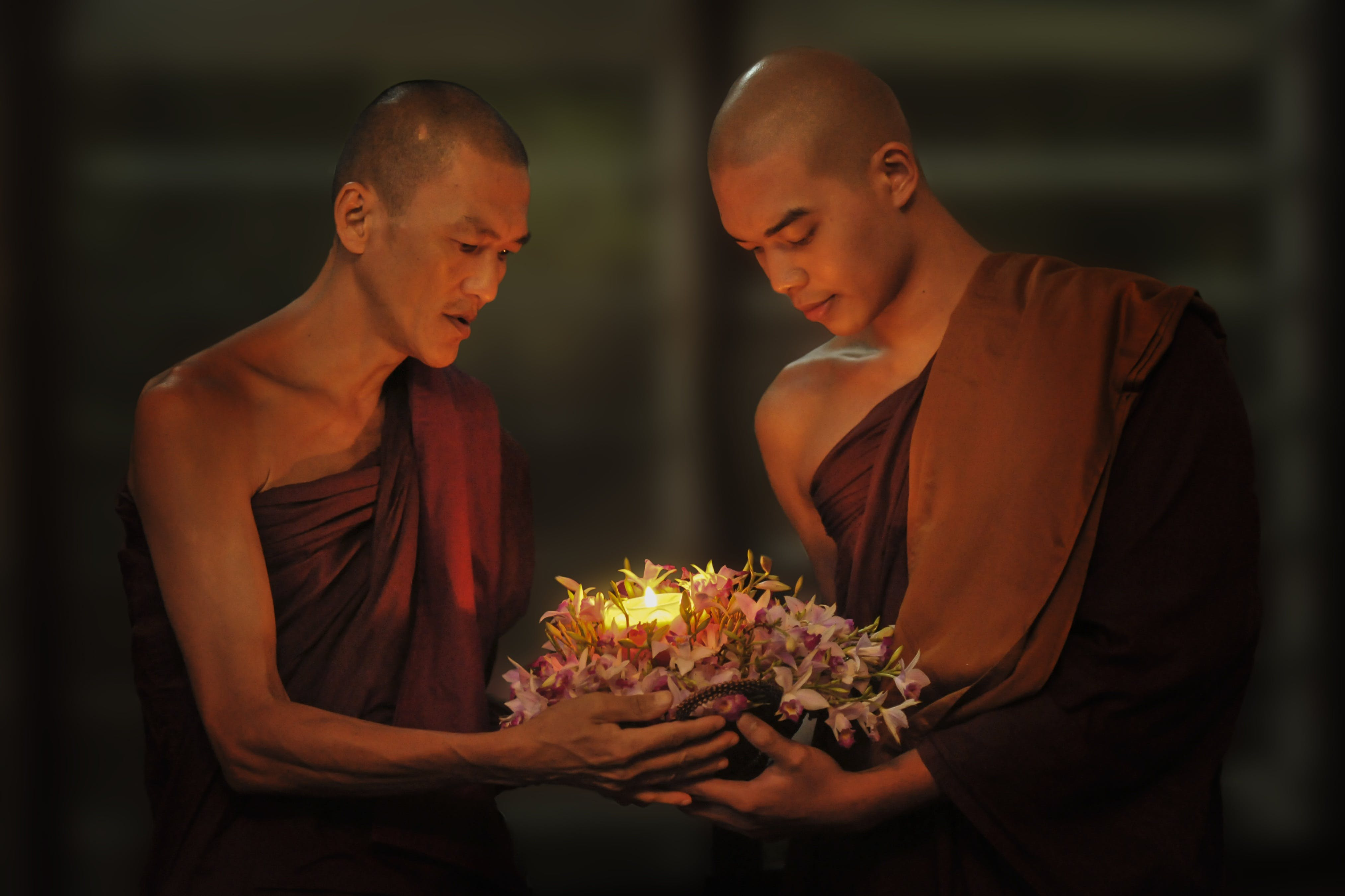 Two Man Monks Holding Light
