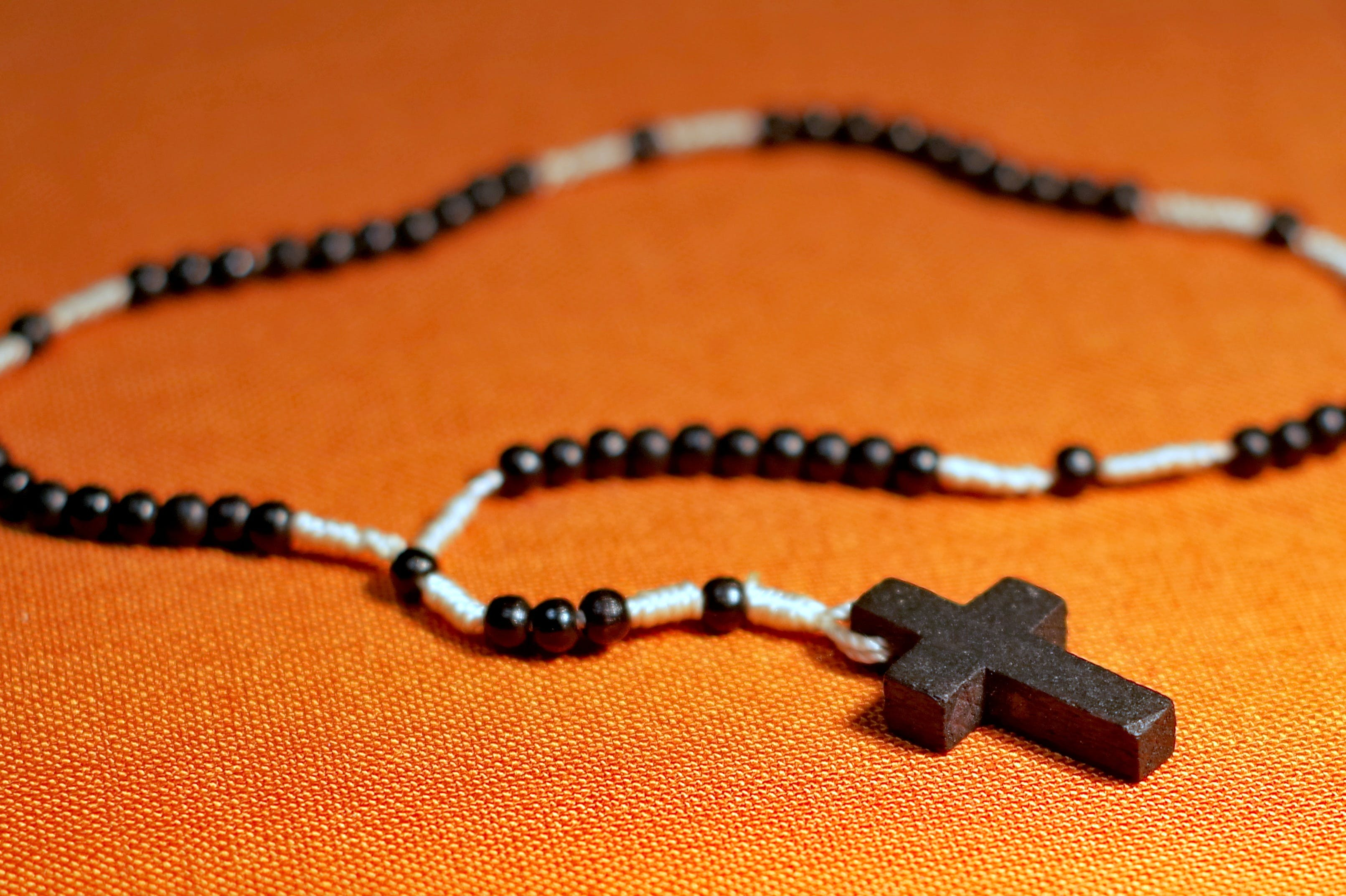 Rosary on Orange Surface