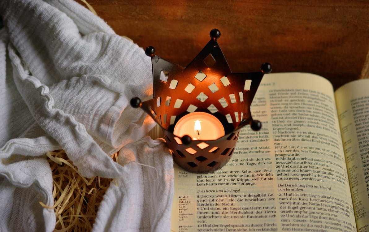Brown and Black Tealight Candle Rack on Book