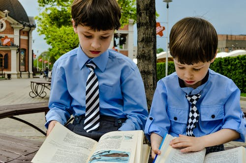 Boys in Blue Shirts Reading Books
