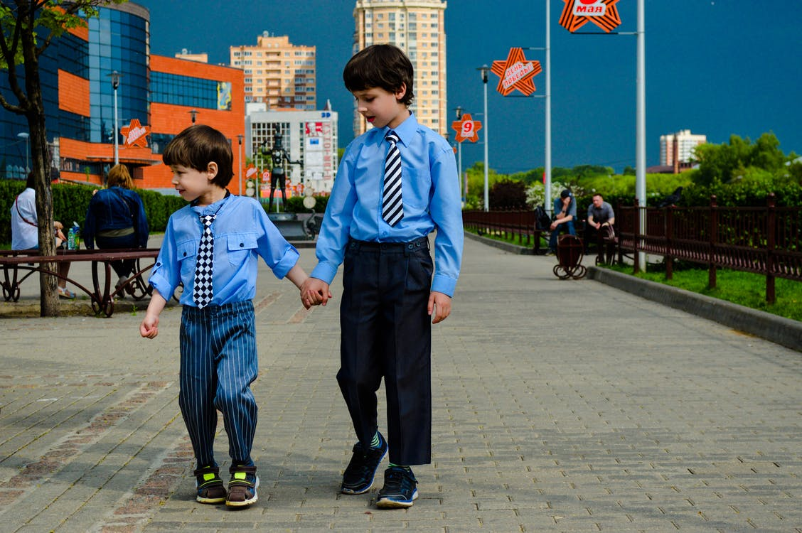 Two Boys Walking on Park