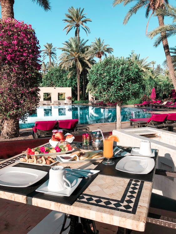 Foods Set on Table by the Pool
