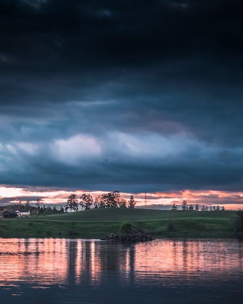 Foto profissional grátis de alvorecer, cair da noite, lago, nascer do sol