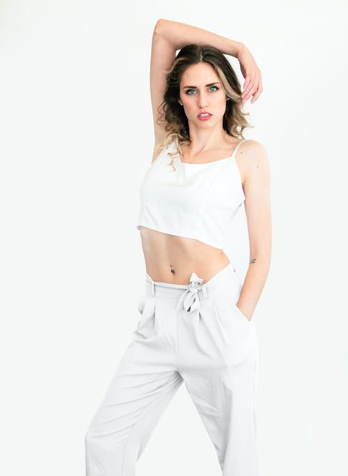 Woman In White Spaghetti Top And Pants