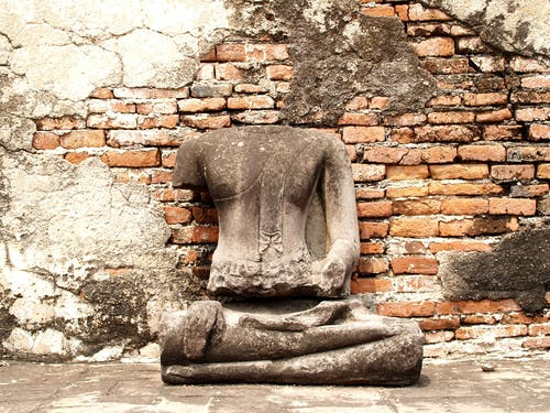 Headless Statue Sited in Front of Wall