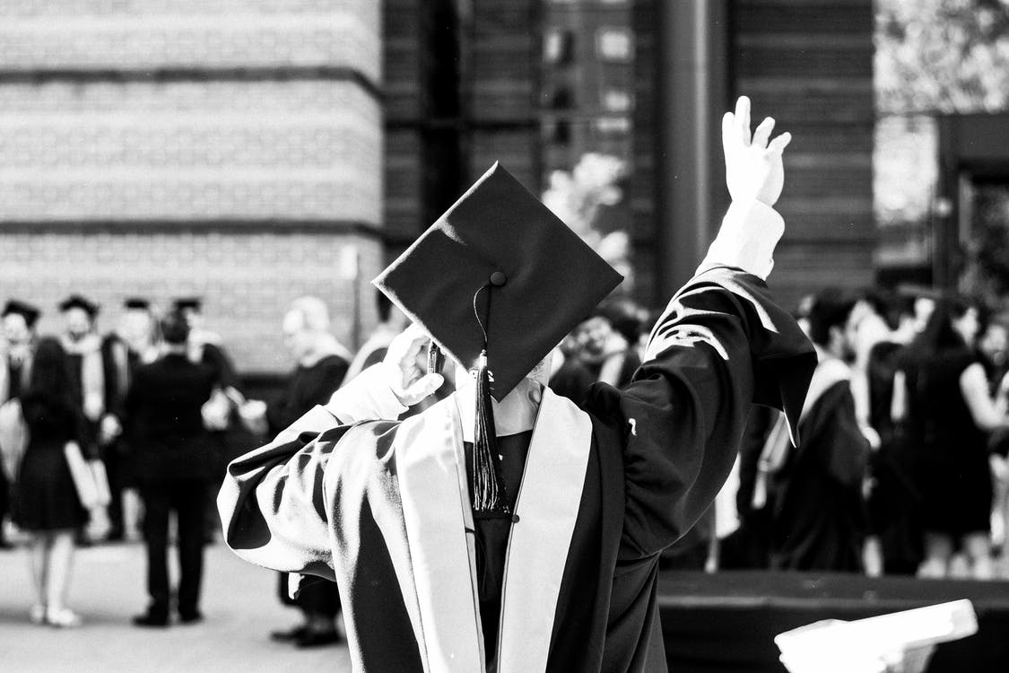 Greyscale Photography Of Person Wearing Academic Dress