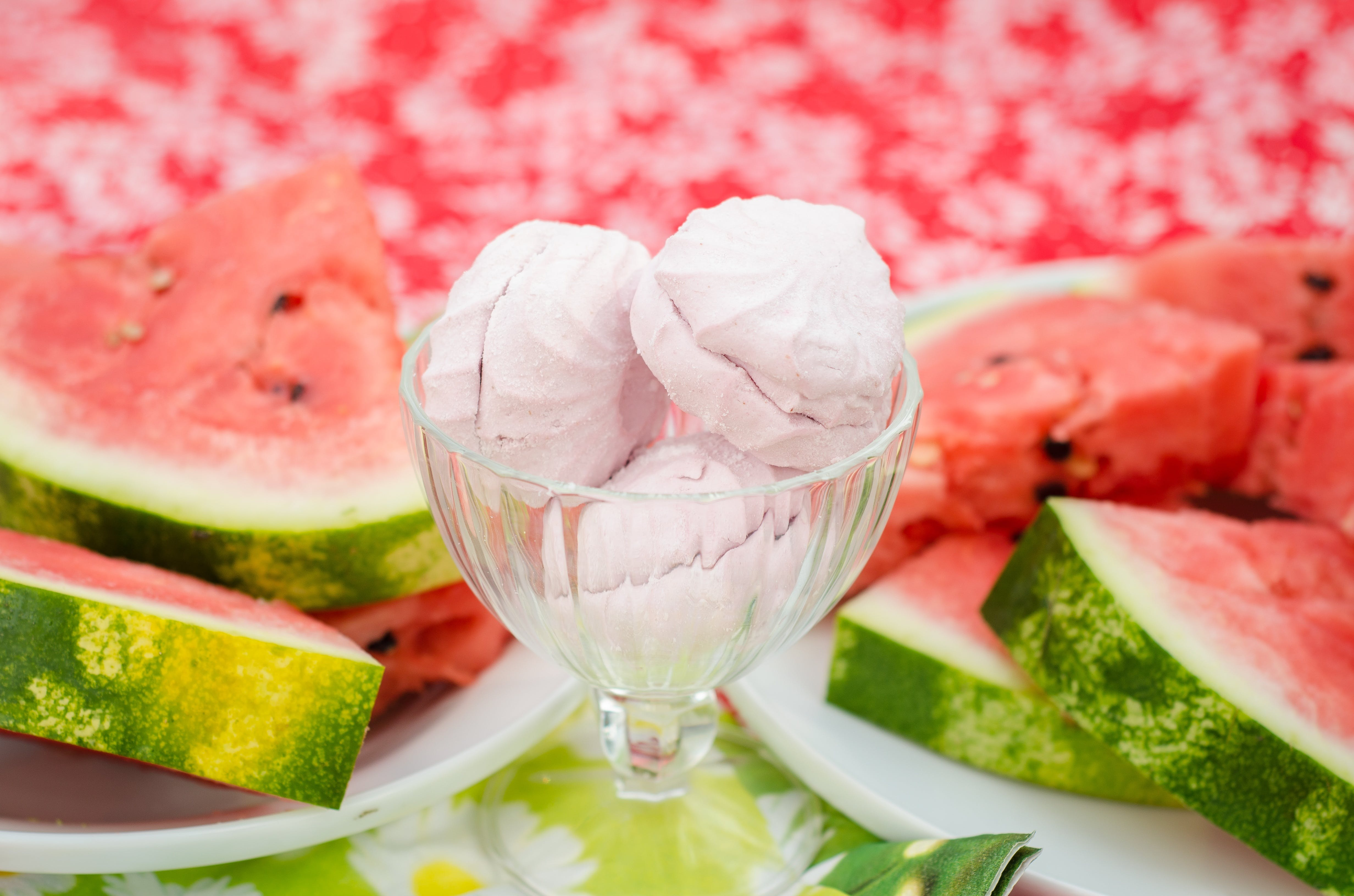 Ice Cream in Glass Cup Beside Sliced Watermelons