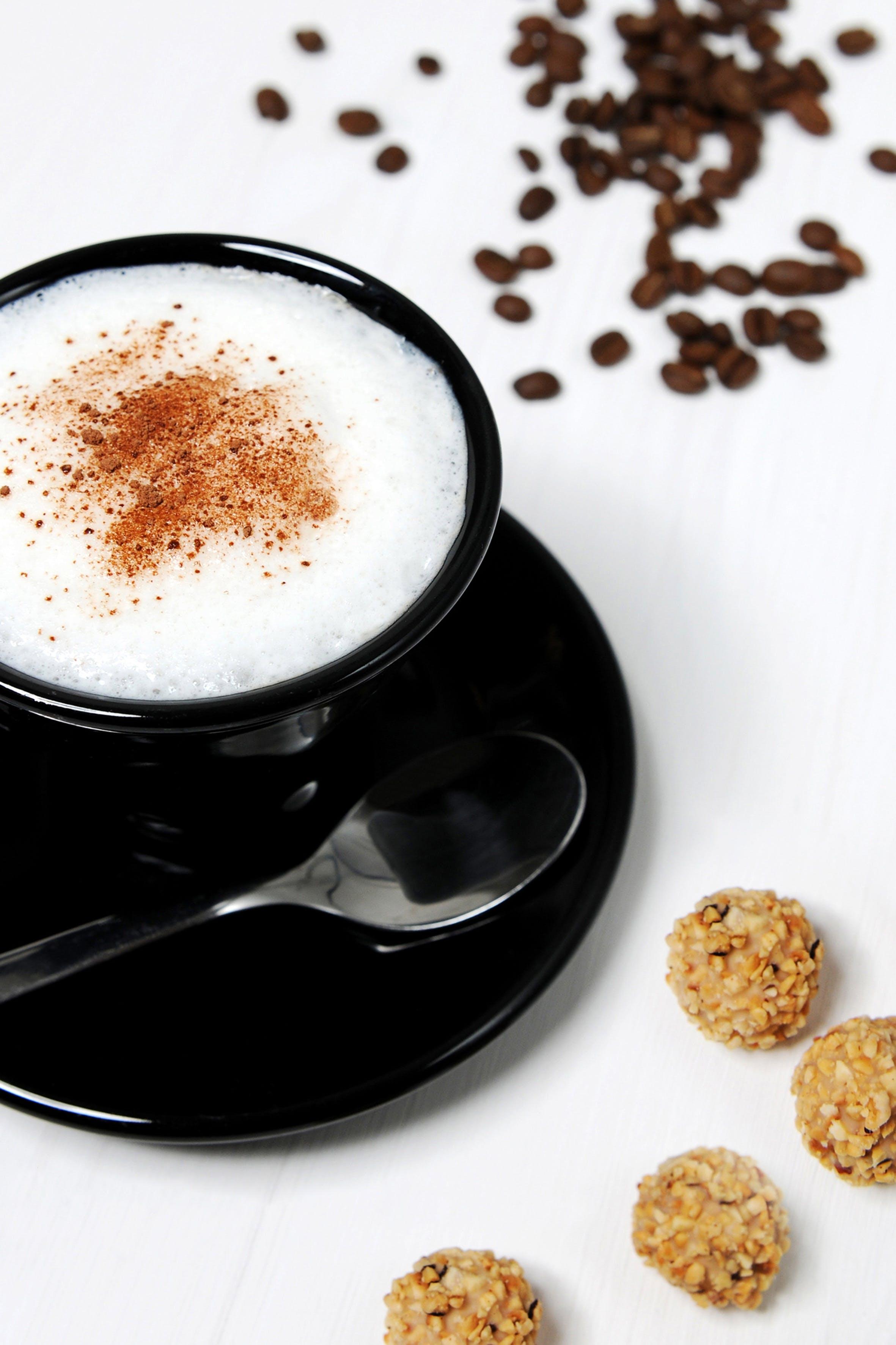 Black Ceramic Teacup With White Liquid in It
