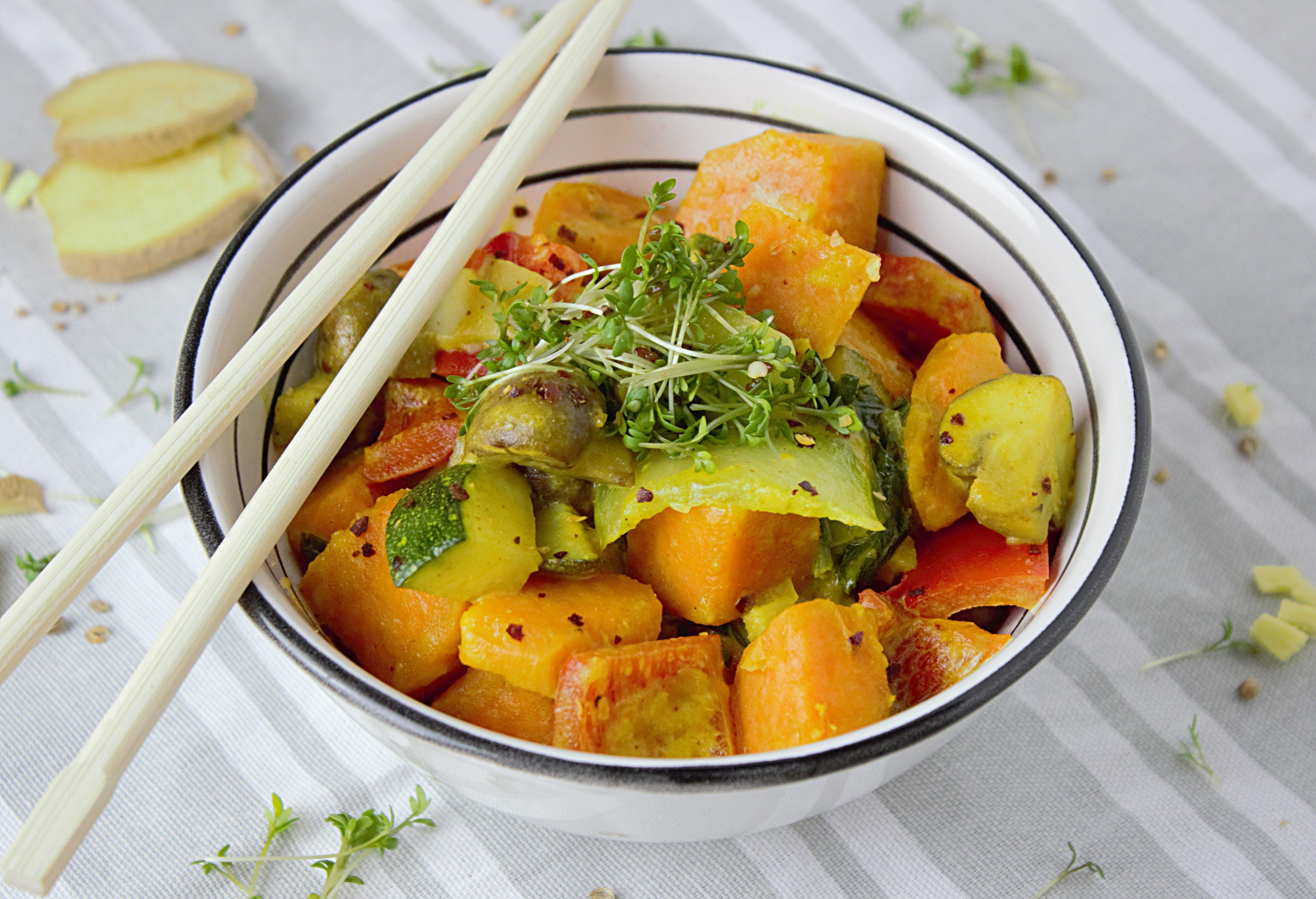 Chopstick on Bowl With Salad Inside