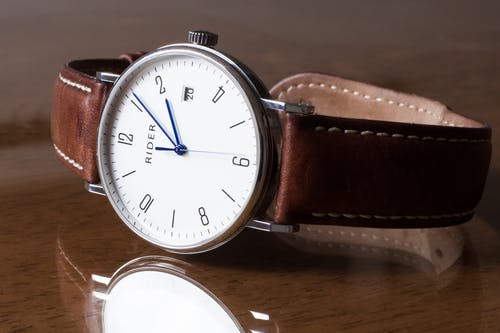 Silver-colored Watch Displaying 2:06
