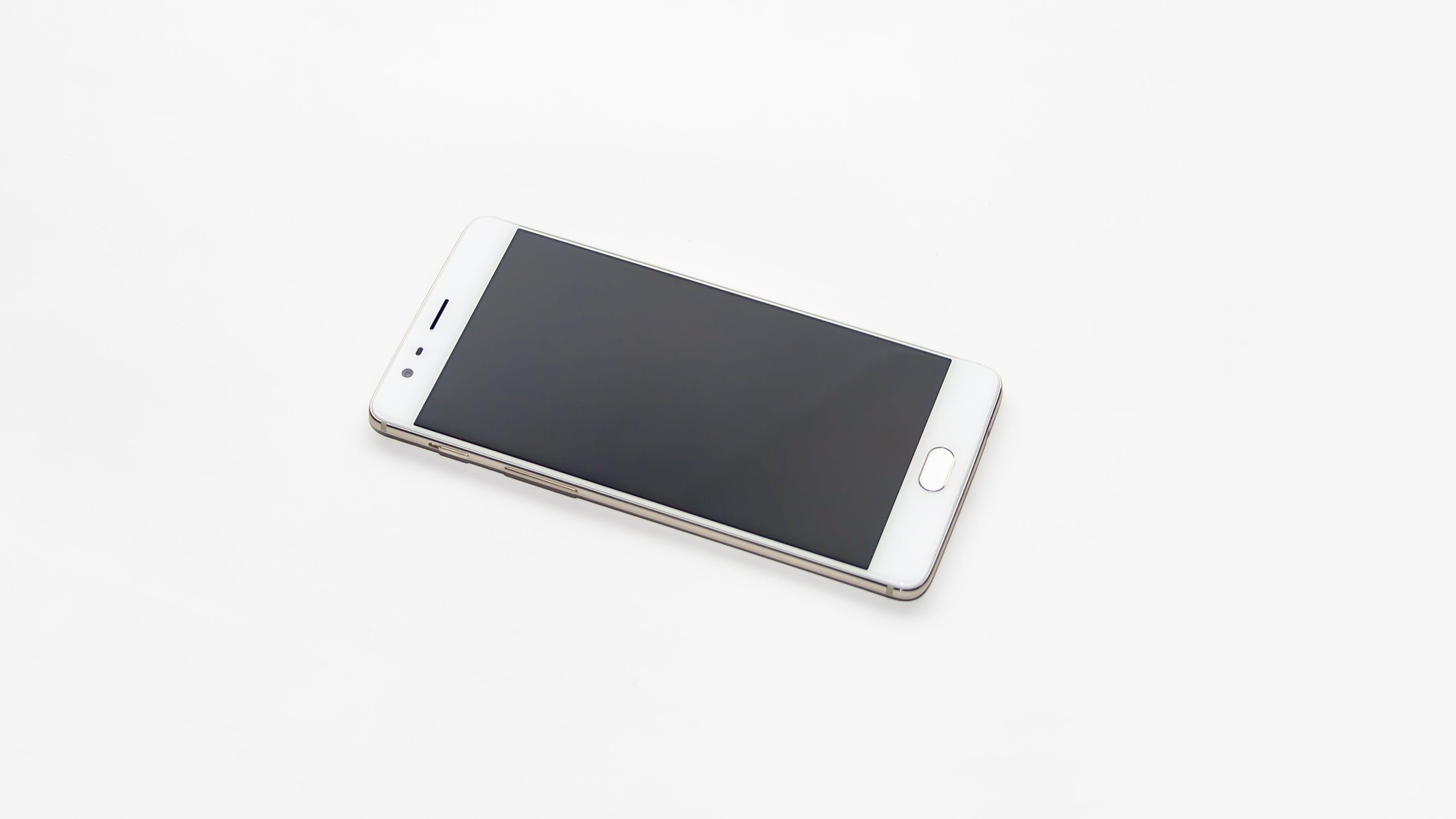 White Smartphone on Black Screen