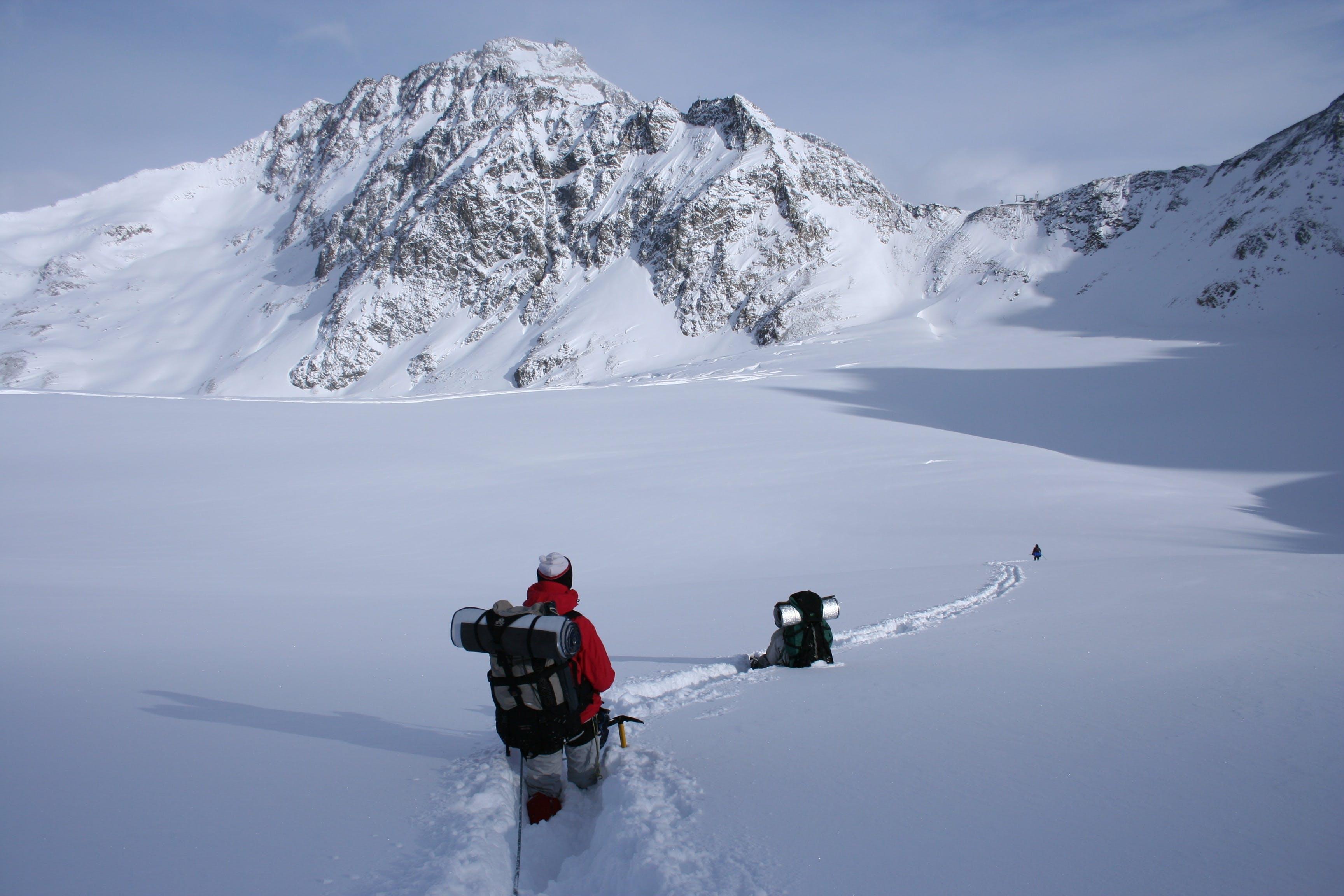 Man Walking on Alps Mountain