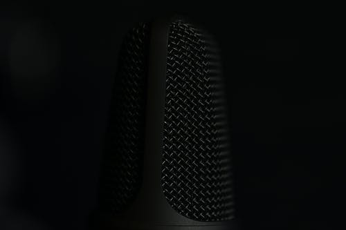 Black and Silver Microphone on Black Background