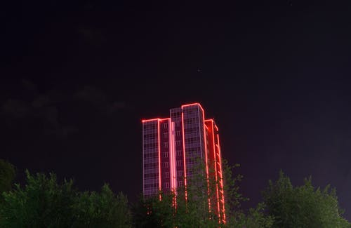 Photography of Lighted High-rise Building during Night Time