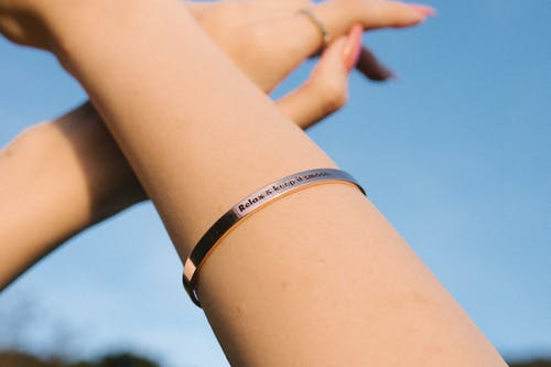 Close-up Photo Of Person Wearing Silver Bracelet