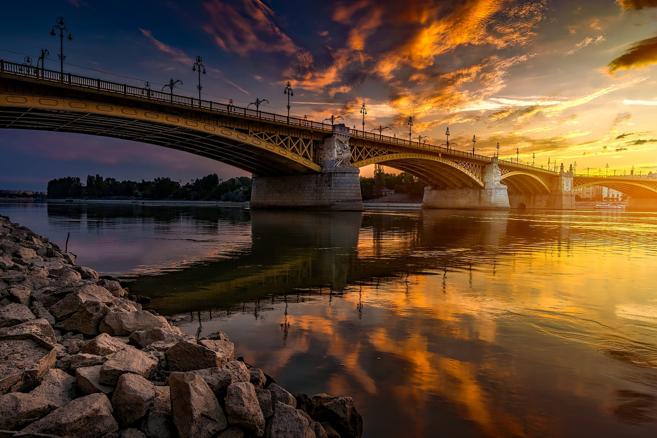 Low-angle Photography of Bridge on Body of Water during Golden Hour Photo