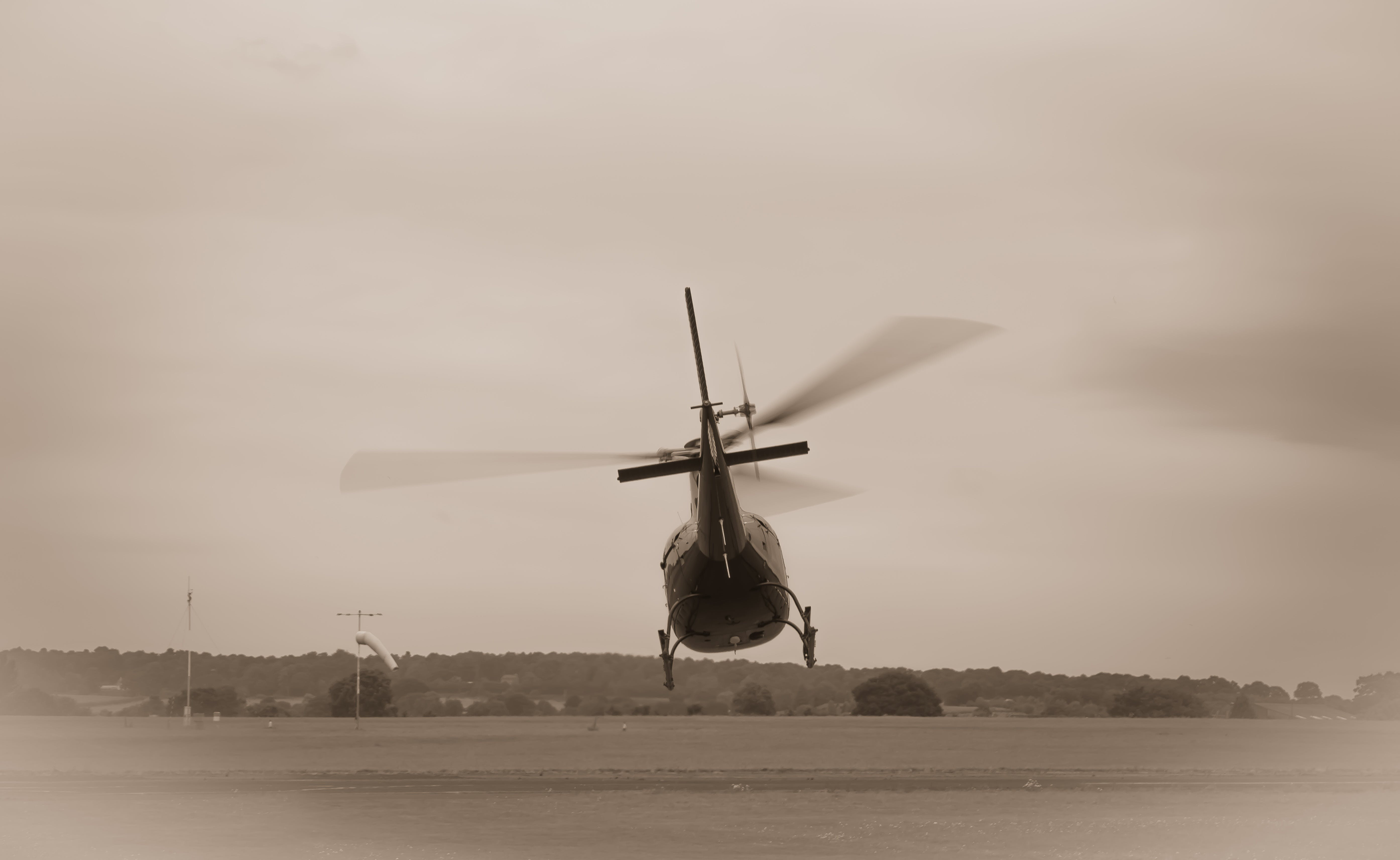 Grayscale Photo of Helicopter