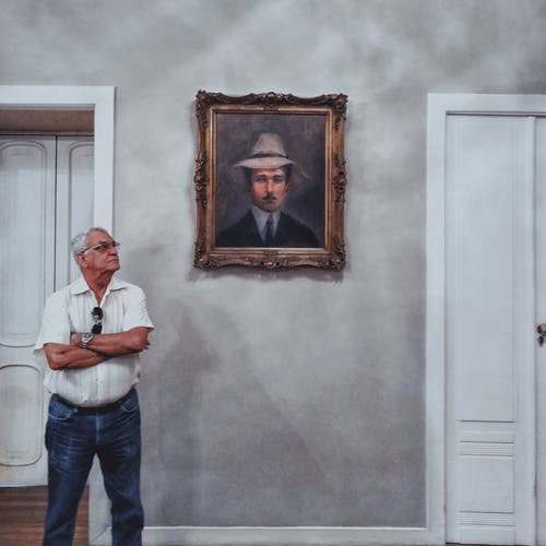 Man Standing Beside Painting
