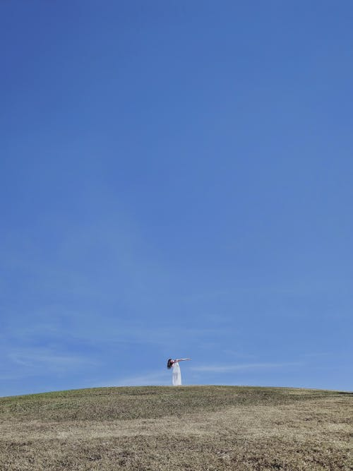 Woman On Top Of Hill
