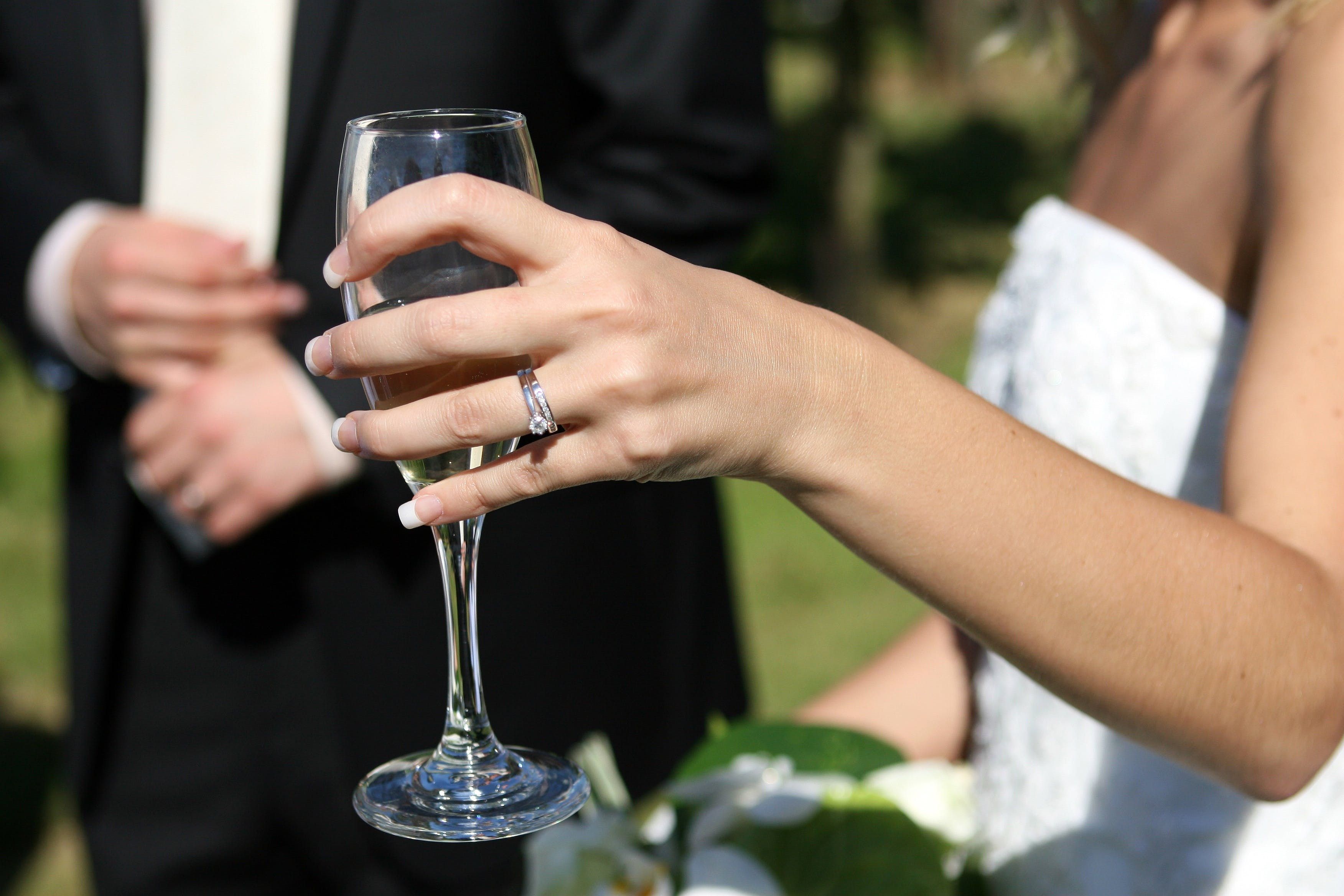 Woman Holding Clear Wine Glass
