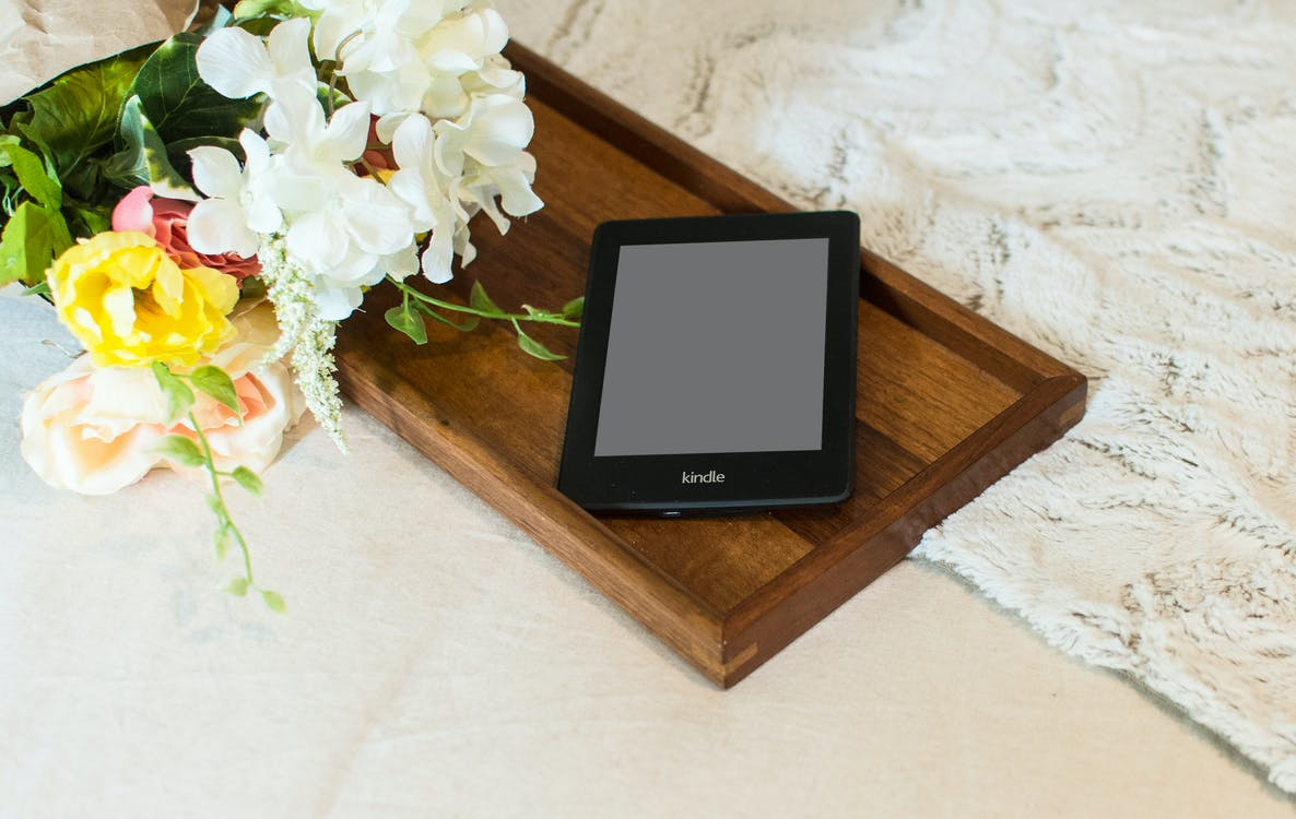 Black Tablet On Wooden Tray