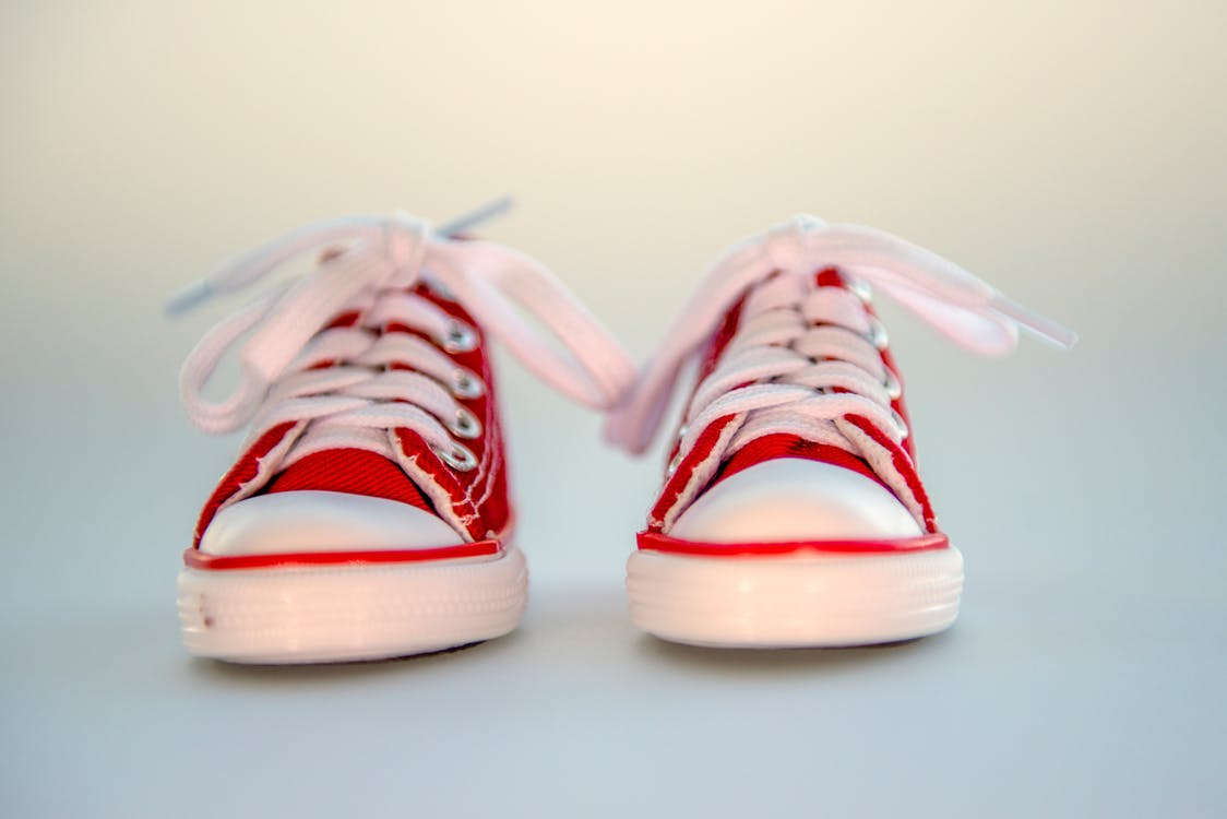 Close-up Photo of Pair of Red Low-top  Baby Sneakers