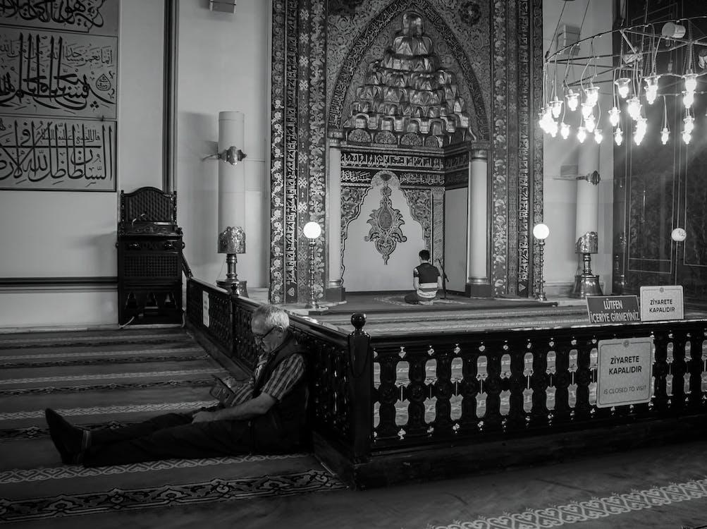 Man Sitting Near Altar