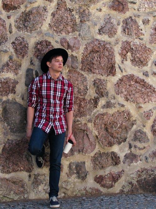 Free stock photo of checked shirt, cobblestone, hat, man