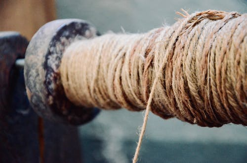Selective Focus Photography of Brown Rope Roll