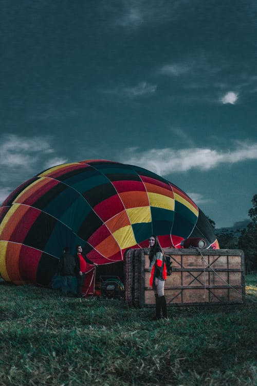 Two People Standing Near Hot Air Balloon