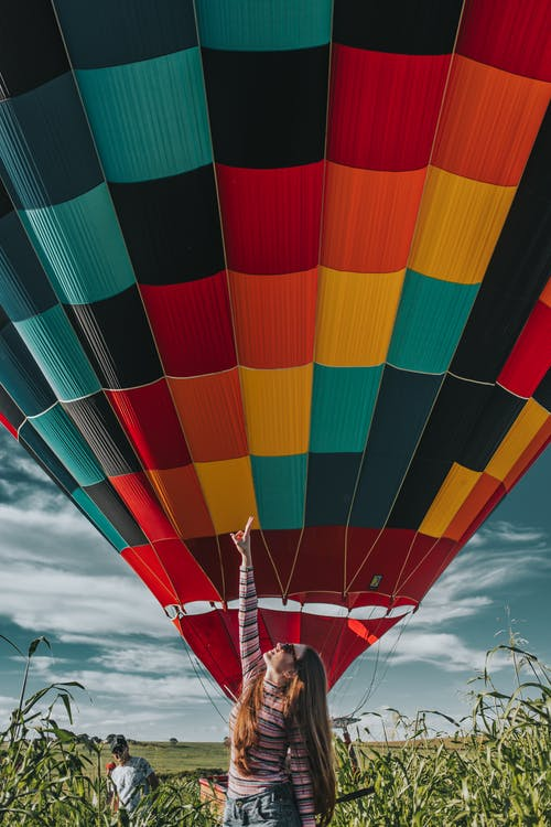 Woman Standing Near Hot Air Balloon