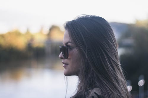 Side View Portrait Photo of Woman in Black Sunglasses