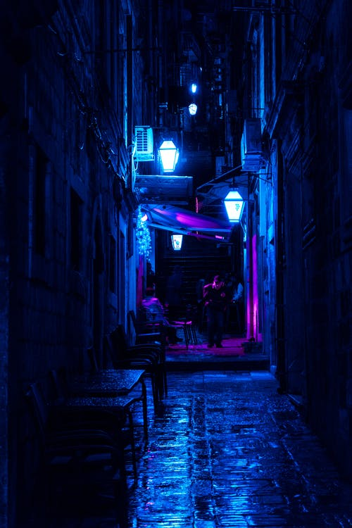 Dark Alley With Turned-on Street Lamps