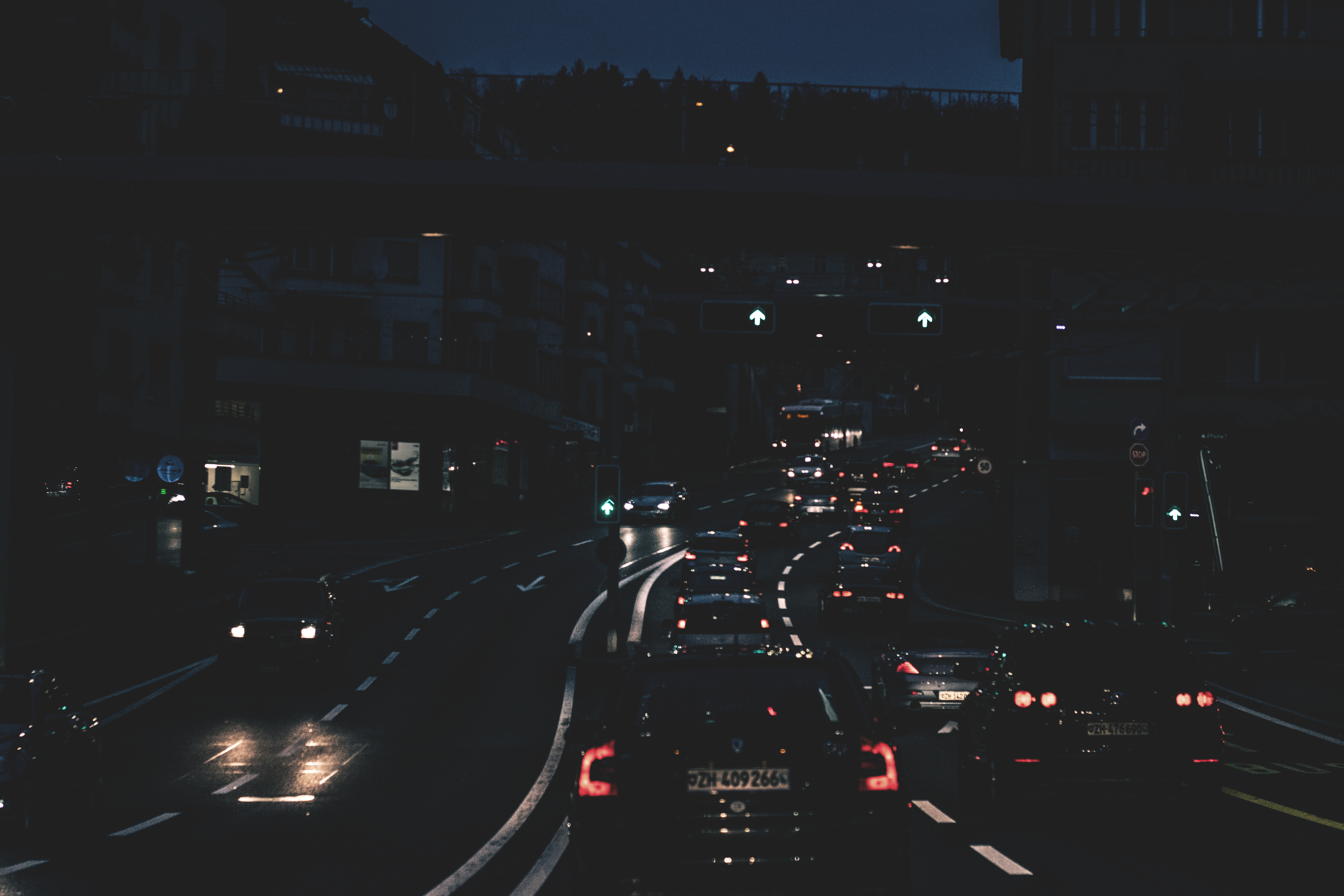 Lighted Street With Cars at Night