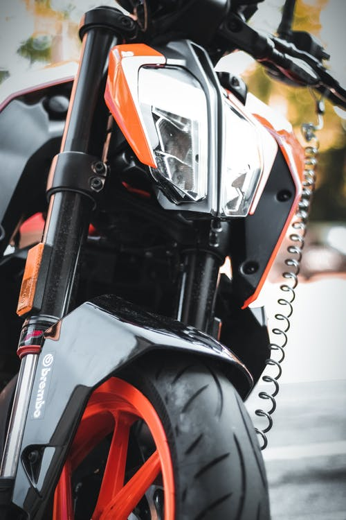 Shallow Focus Photo of Black and Orange Motorcycle