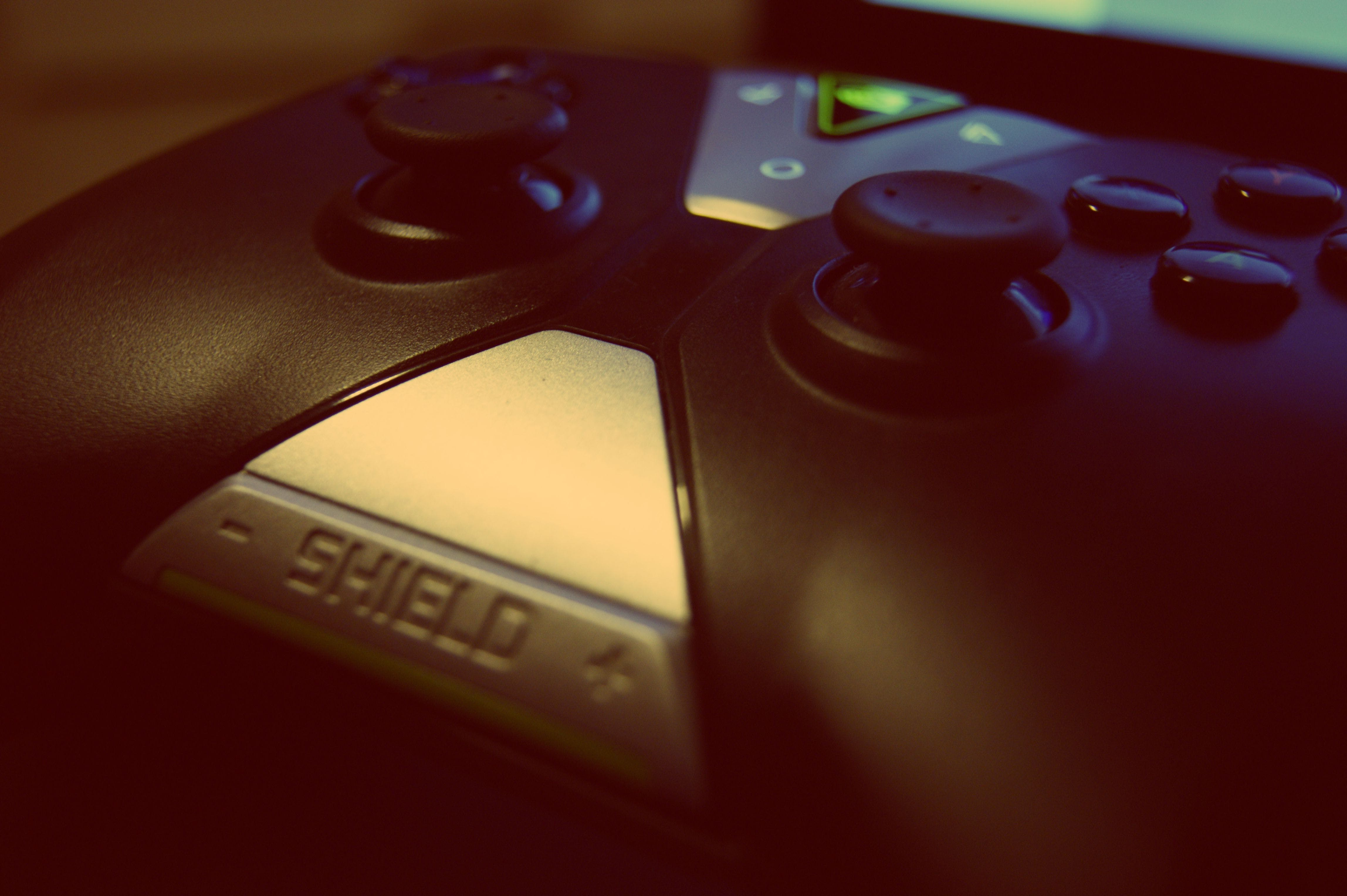Black Shield Game Controller Close-up Photography