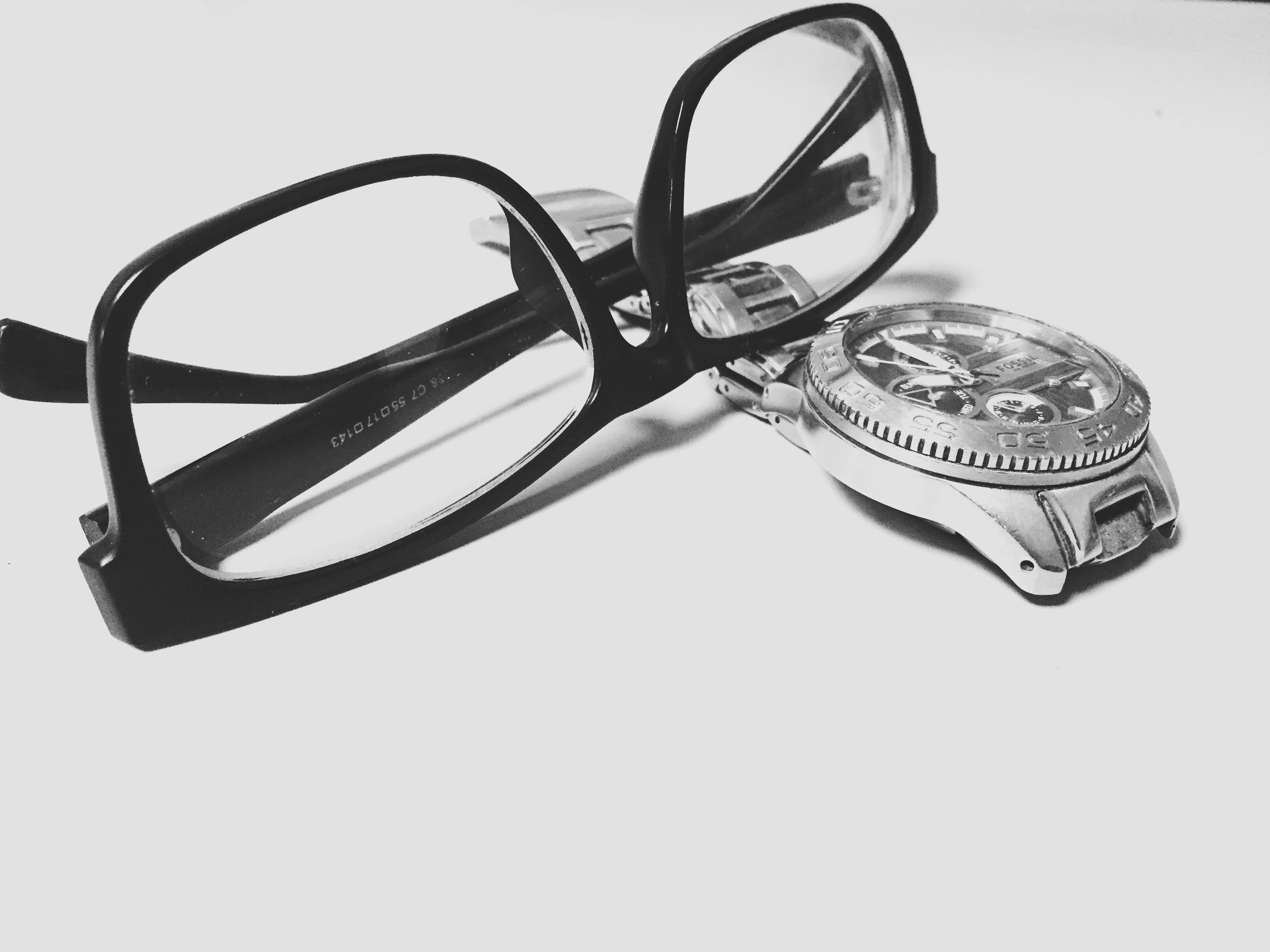Grayscale Photography of Black Framed Eyeglasses on Watch