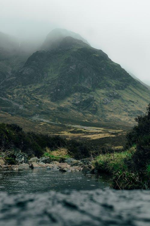Majestic mountain peak hidden in cloudy sky
