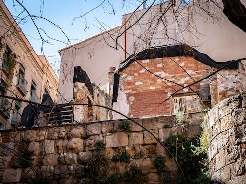 Foto stok gratis bangunan tua, barcelona, dinding, dinding batu